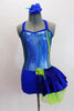 Iridescent blue/silver/green swirled metallic halter style unitard has blue bottom with attached skirt on left hip. Comes with matching blue hair accessory. Front