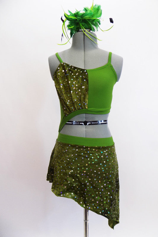 Green and olive two piece dress is attached at the hip. The bottom has a sheer sequined skirt and accented on the half-top. Comes with a matching green feather hair accessory. Front