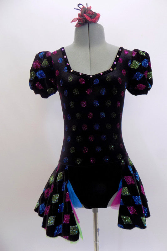 Black velvet dress has pouf sleeves & open front skirt with tulle layers. Glitter colour designs in diamonds & dots cover the dress. Comes with hair accessory. Front