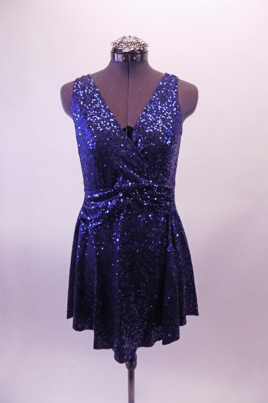 Simple but stunning royal blue fully sequined cross-front dress has gathered waist and low scoop back. Comes with a hair accessory. Front