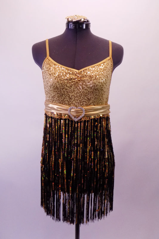 Gold and black flapper-style dress has gold swirl sequined base. The gold and black fringe skirt extends from a thick sequined band and gold belt with crystal heart belt buckle. Comes with a gold hair accessory. Front