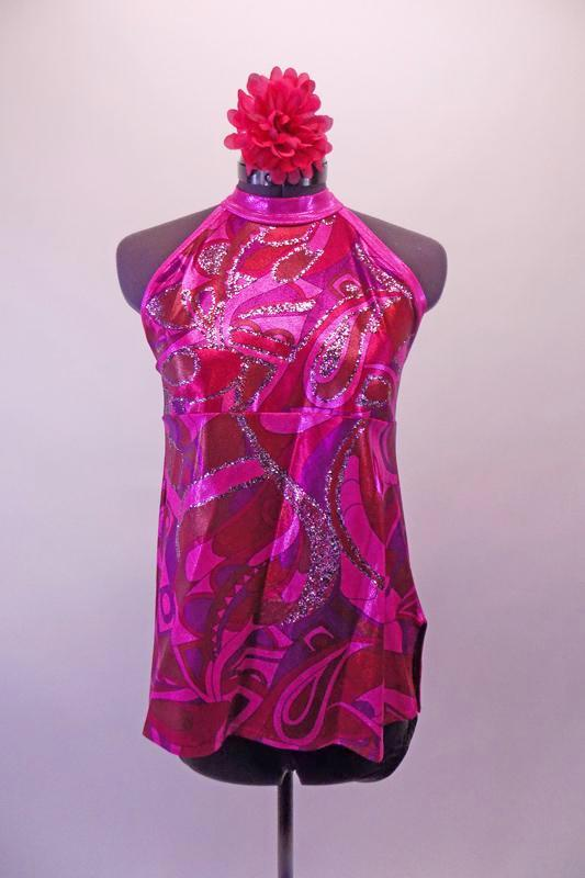 Pink purple and red 60s inspired high neck halter style A-line top has swirled design on a pink metallic base Comes with black shorts and matching hair accessory. Front