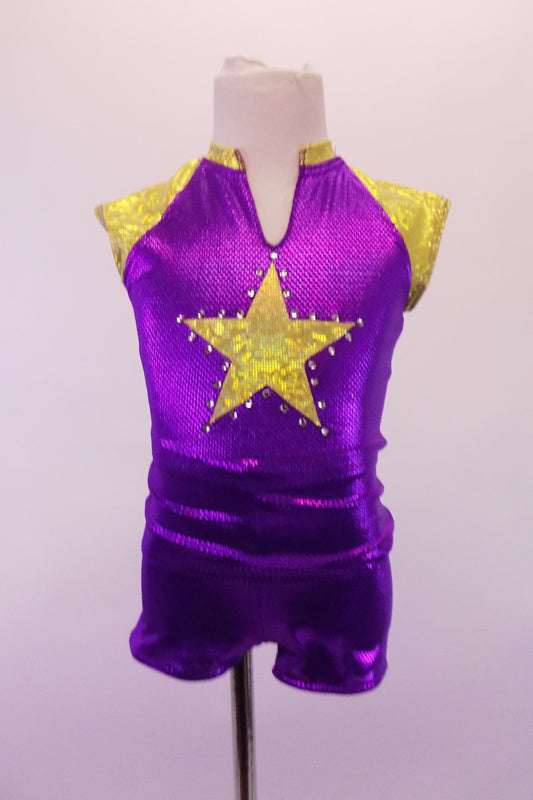 Purple and gold two-piece costume has a sporty feel with large crystal lined gold star at the front and one at the back pocket of the short. The gold shoulders and collar accent the stars. Front