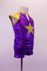 Purple and gold two-piece costume has a sporty feel with large crystal lined gold star at the front and one at the back pocket of the short. The gold shoulders and collar accent the stars. Side