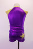 Purple and gold two-piece costume has a sporty feel with large crystal lined gold star at the front and one at the back pocket of the short. The gold shoulders and collar accent the stars. Back