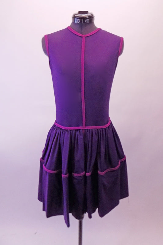 Purple knee-length traditional dress has a magenta band accents at the binding and gathered full skirt. The fully lined dress falls nicely as it moves. Front