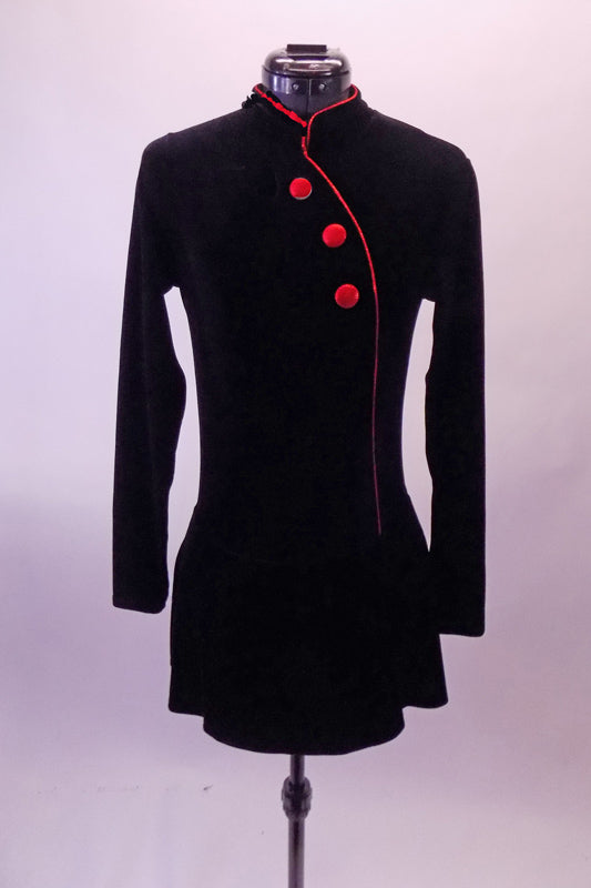 Black velvet mandarin collar long sleeved dress has asymmetric front closure and three red buttons. Front