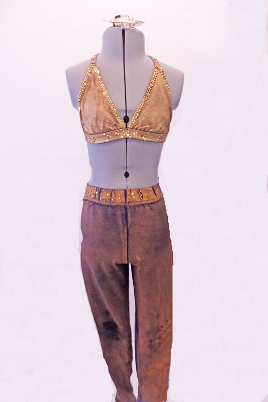 Two-piece costume has a stretch denim base with a gold over-dye. The halter-neck triangle bra is edged completely with amber crystals. The matching jegging has a crystalled waistband. Comes with a gold hair accessory. Front