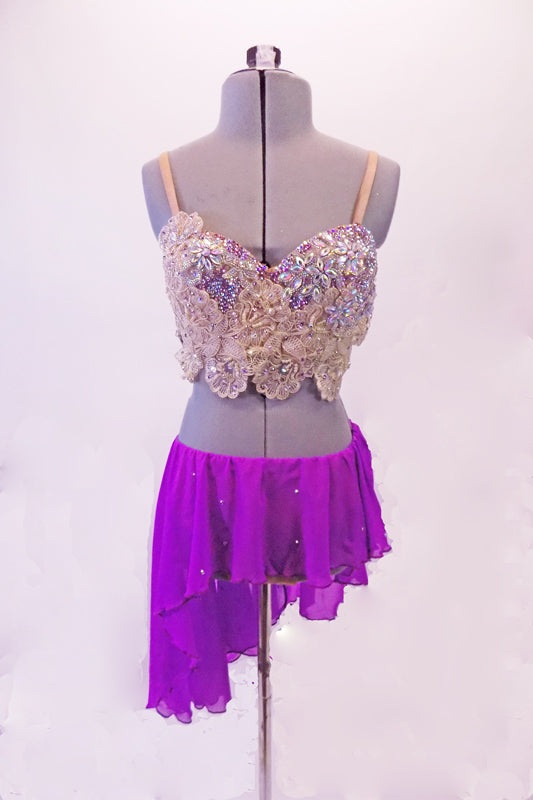 2-piece lyrical costume has a lavender chiffon angled skirt with an attached brief and scattered crystals. The breathtaking haft-bra top is comprised entirely of ivory beaded lace with Swarovski crystals and pearls. Comes with a lavender floral hair accessory. Front