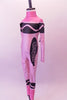 Pink high halter collared, long-sleeved full unitard Has all the markings of a life sized-crayon. Side