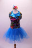 Colourful costume has a turquoise tulle skirt with rainbow sequin waistband, attached to a turquoise short unitard base. The brightly coloured graffiti-style vest has shiny blue lapels with wide rainbow sequin accent. Comes with matching gauntlets and hair accessory.