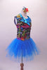 Colourful costume has a turquoise tulle skirt with rainbow sequin waistband, attached to a turquoise short unitard base. The brightly coloured graffiti-style vest has shiny blue lapels with wide rainbow sequin accent. Comes with matching gauntlets and hair accessory. Right side