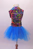 Colourful costume has a turquoise tulle skirt with rainbow sequin waistband, attached to a turquoise short unitard base. The brightly coloured graffiti-style vest has shiny blue lapels with wide rainbow sequin accent. Comes with matching gauntlets and hair accessory. Back
