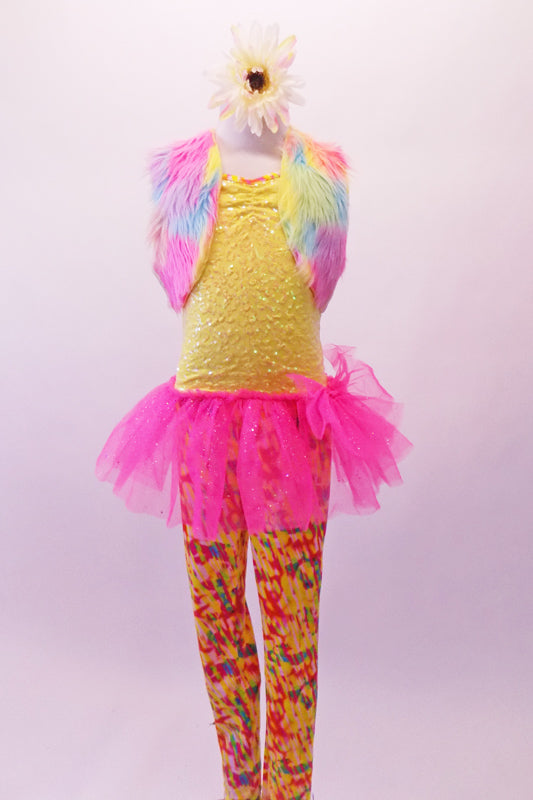 Full unitard has a yellow sequined bodice and colourful patterned legs. The bright pink attached tutu skirt with a large bow adds a bit of fun, while the pastel coloured fur vest completes the whimsy. Comes large daisy flower hair accessory and yellow sequined gauntlets. Front