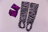 Zebra print stirrup stockings and purple sequined gauntlets.