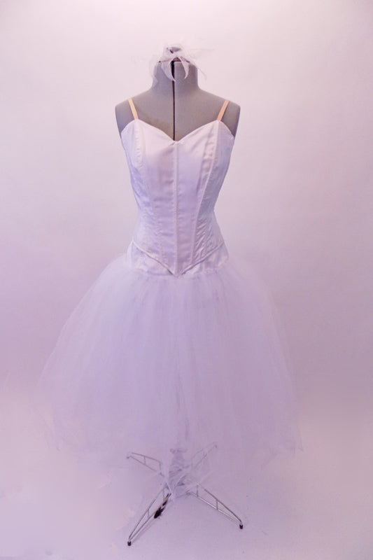 White romantic tutu skirt with attached wide basque lays beneath a peaked-front princess-cut Russian style, boned bodice. The back closes with hook & eye and straps are nude. The costume is simple yet classic & can be decorated further with feathers & crystals. Comes with white hair accessory to fit over a bun. Front