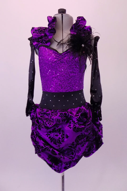 Unique costume has purple sequined bodice. The bodice has an attached gathered halter collar that matches the purple & black velvet damask print, pin-tuck skirt. The wide black crystalled waistband compliments the long black crystalled gloves. Black feathers accent the left shoulder & the matching hair accessory. Front