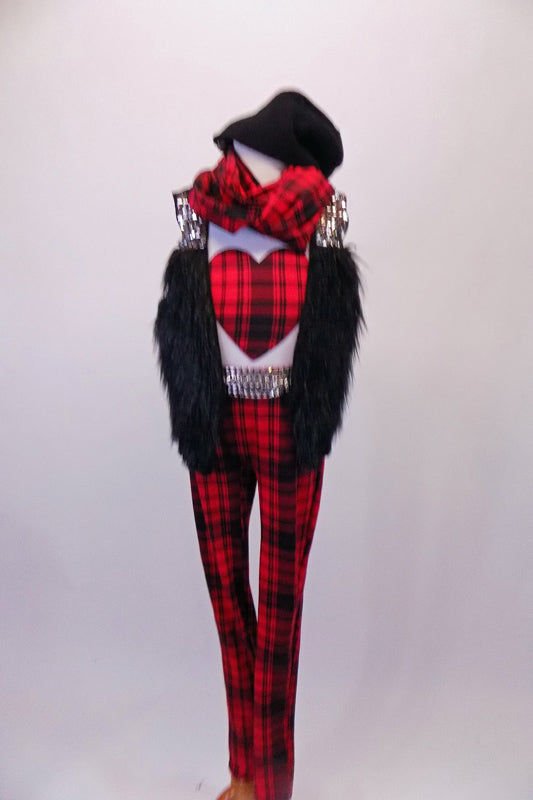 White tank top with red and black plaid heart is accompanied by matching plaid pants and sequined studded belt. A black furry vest with sequined shoulder sits over the white tank. The costume is completed by a matching plaid unity scarf and a black toque. Front