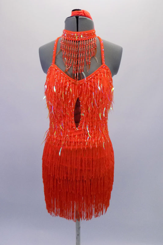 Bright orange, tie-up halter style dress covered entirely in beaded dangle sequins and fringe. The top is a sweetheart neckline with built-in cups and an open back bottom/skirt portion is comprised entirely of layers of orange fringe. Comes with orange sequined necklace accessory and separate orange brief. Front