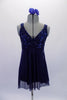 Navy blue empire cut baby-doll dress had a sequined bust and flowing knee-length chiffon shirt. The dress has an attached brief and comes with a floral hair accessory. Front