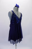 Navy blue empire cut baby-doll dress had a sequined bust and flowing knee-length chiffon shirt. The dress has an attached brief and comes with a floral hair accessory. Side