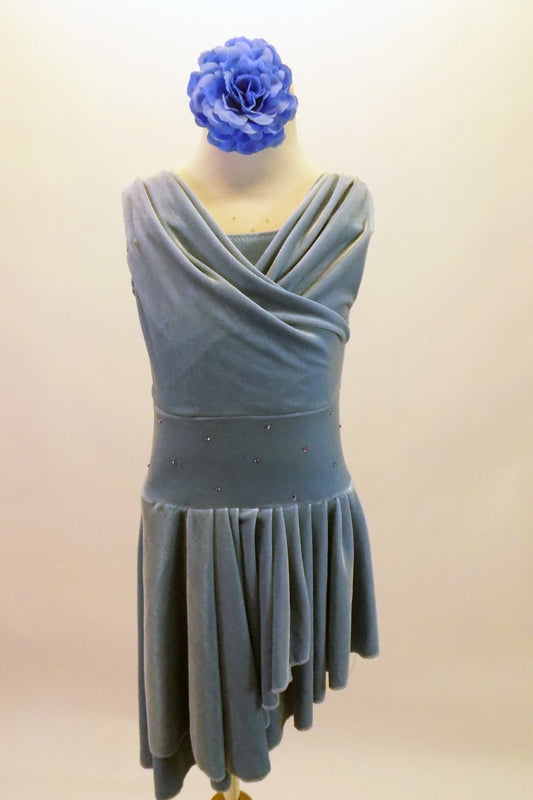 Cornflower blue velvet dress has a draping cross-over front to accentuate the cross front, high-low side skirt. The skirt is full and moves beautifully on stage. The wide waistband is covered with scattered crystals. Comes with separate matching briefs and headband. Front