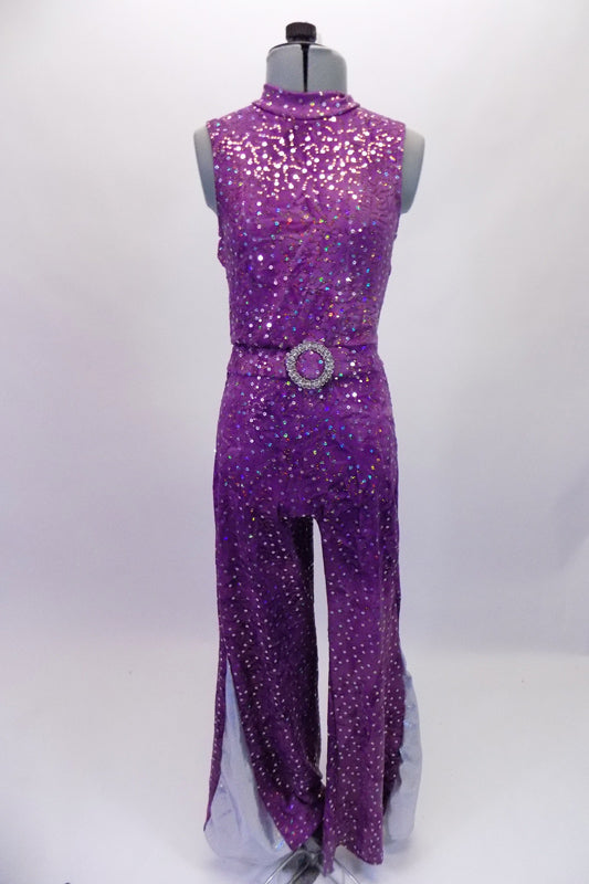 "Fully sequined purple unitard with deep open back and tank-style front. The attached belt has a large crystal belt buckle for that extra bling. The pant legs are wide bottom for that 70s feel and have a glittery silver side insert (inseam 30""). Comes with a purple hair accessory. Front"