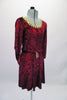 Burgundy crushed velvet, A-line tunic dress has glitter floral detail in the fabric and gold sequined braid that sits along the neckline. The ¾ angel-sleeve gives the dress a medieval look. Comes with tie belt and hair accessory. Side