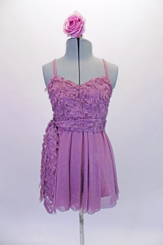 Pretty pale mauve purple, camisole dress has ribbon rose bodice and sash with cross back. The flowing skirt has a lovely subtle shimmer and cascades in the back. Comes with a rose hair accessory. Front