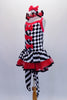 Harlequin themed tutu dress is an alternating pattern of black-white stripes & black-white checks. A red tulle skirt with black satin ribbon makes the skirt & matches the ruffled collar. Three red bows accent the bodice. Comes with red hair bow & stirrup socks. Side