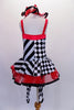 Harlequin themed tutu dress is an alternating pattern of black-white stripes & black-white checks. A red tulle skirt with black satin ribbon makes the skirt & matches the ruffled collar. Three red bows accent the bodice. Comes with red hair bow & stirrup socks. Back