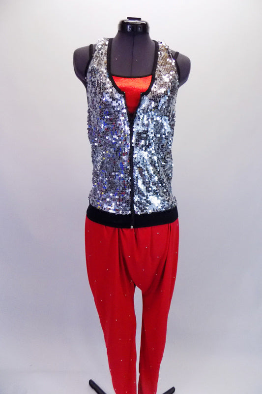 Red metallic camisole crop top sits beneath a silver sequined halter vest with zip front. Red harem hip-hop pants with scattered crystals complete the outfit. Front