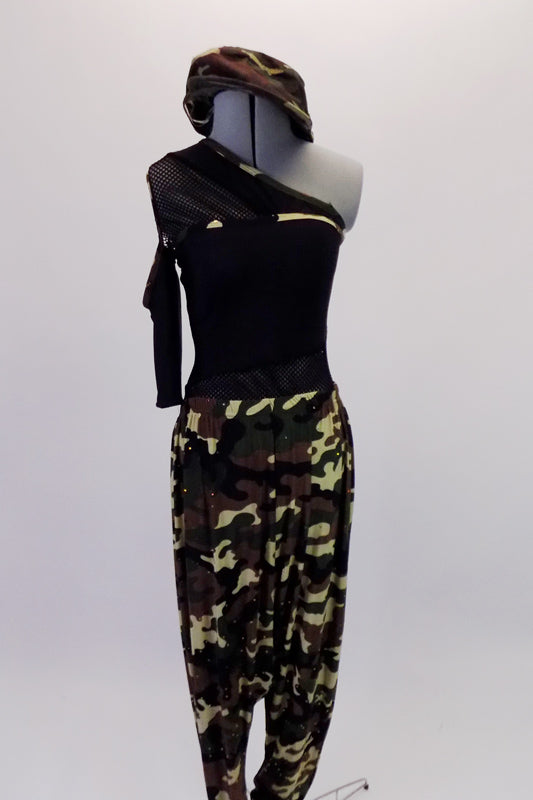 One shoulder top with mesh accents at the waist. The right shoulder is a cold shoulder single mesh sleeve. Camouflage print harem pants accompany the top which also has some camouflage accents. Comes with a camouflage newsboy hat. Front