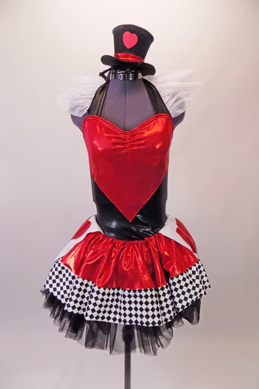 Halter style leotard dress has a large red heart front over a back base with ruffled organza collar. The attached skirt is shiny red with a black & white houndstooth edge over the top of black tulle. Two large white & red heart panels accent each of the hips. Comes with a mini black top hat with a heart accent.  Front