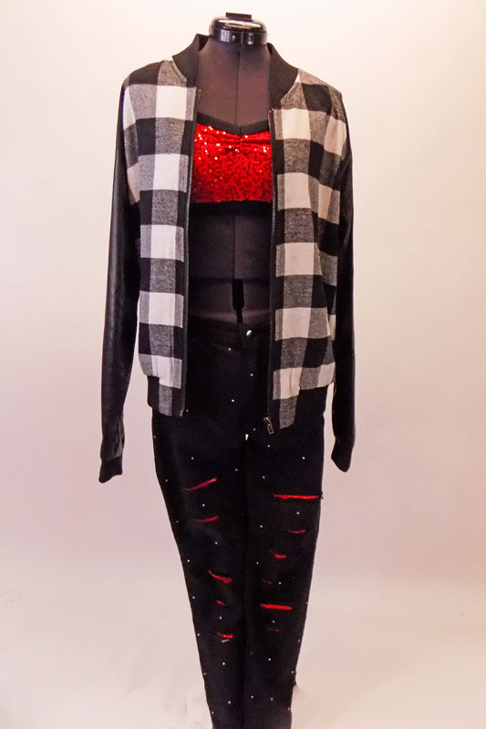 This costume has black shred jeans with a red accent that is covered in scattered crystals. The red sequined bra top accompanies the jeans and sits beneath a black and white plaid jacket with leatherette black and sleeves. Top