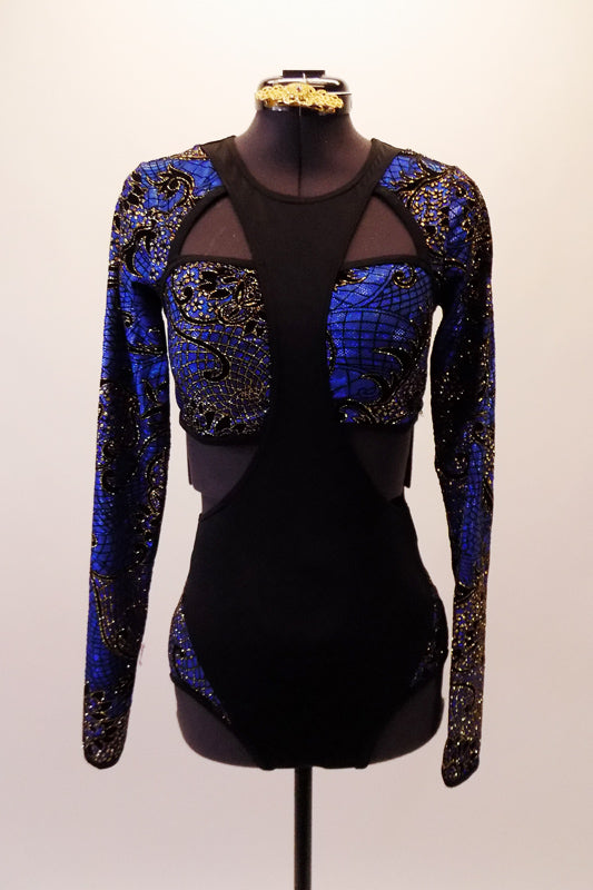 Unique leotard has a figure 8 black front torso that crosses a bandeau-style bust of blue-black and gold floral stained glass pattern. The long-sleeved shrug is attached to the uniquely shaped black front that extends to form the neckline. Comes with a gold hair accessory. Front