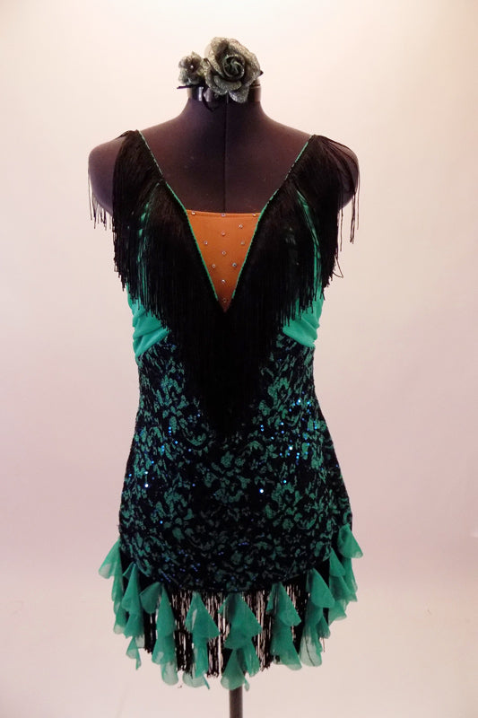This sassy costume is a black lace and aqua dress with deep plunge front and nude centre inset with crystal accents. Wide black fringe extends from the centre of the bust along the shoulders to the back. Black fringe and ruffled aqua cascade mini ruffles edge the dress. Comes with a floral hair accessory. Front