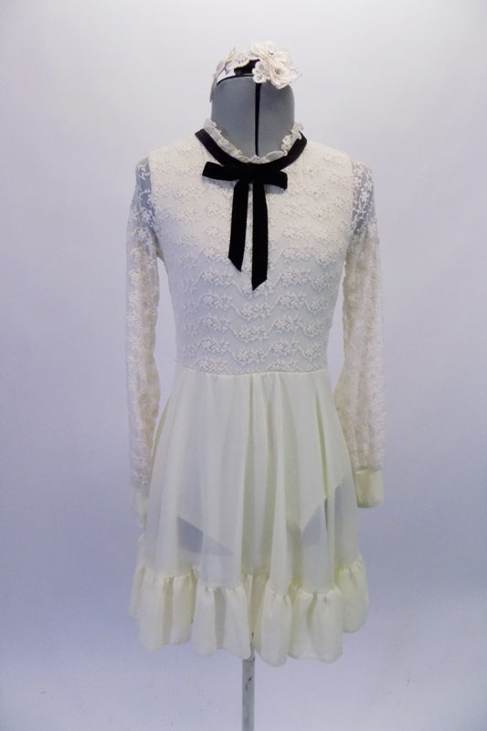 Delicate ivory dress has full lace upper with ruffled neck and black velvet tie accent. The knee-length chiffon skirt has a large ruffle edge. Comes with a beautiful lace hair accessory. Front