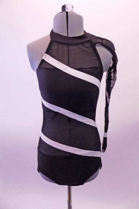 Black halter leotard has open back, solid bust and bottom while the rest is black sheer mesh.  White angled stripes cross the torso both front and back. The left sheer sleeve is attached to the collar at the left shoulder. Front