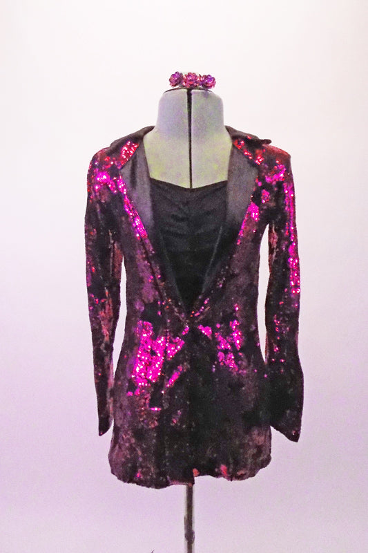 Fuchsia coloured full sequined blazer has a black star pattern and satin lapels. The blazer sits over the top of a simple black short unitard with gathered bust and camisole straps. Comes with matching hair barrette. Front