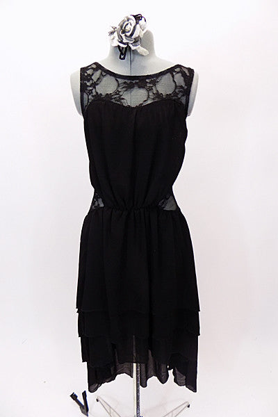 Black high-low layered chiffon dress has lace upper bodice and side inserts. Back is lace and lycra for additional stretch. Comes with floral hair accessory. Front