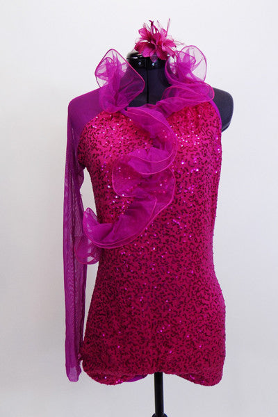 Hot pink sequined lace short unitard has halter neck & curly  pink organza cascading down the front. Right sleeve is full mesh. Comes with matching hair accessory. Front