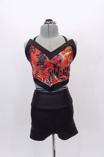 Red graffiti, brick patterned, halter half-top, has corset back & matching quilted, leather-like, high-waisted shorts. Comes with matching crystal hair piece. Front