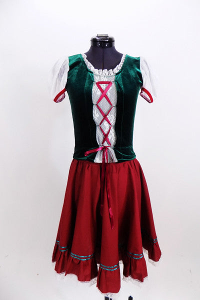 Two piece ballet or character costume has a dark green velvet stretch bodice with lace sleeves & a corset style front. Comes with fuchsia ribbon detailed skirt & floral hair wreath. Front