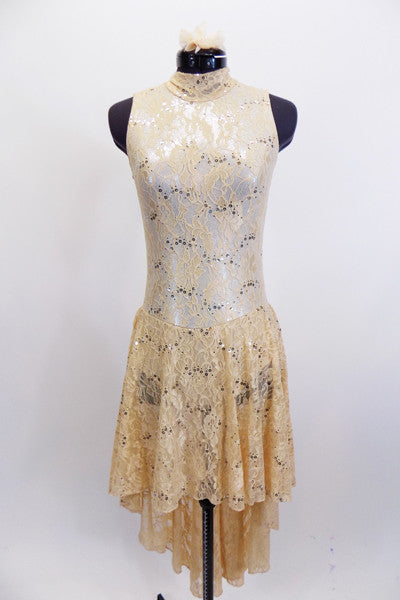 Nude sequined lace covers a silver base on this high neck dress with keyhole back. Has attached sheer lace hi-low skirt & matching floral hair accessory. Front
