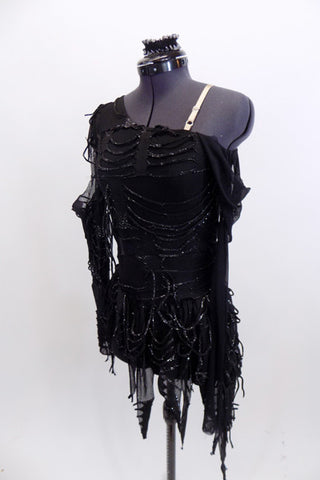 Unique costume is a one shoulder leotard with layers of web-like silvered covered tattered accents, The sheer sleeves and skirt  have matching loopy webs. Front