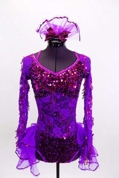 Bright purple lace & sequined, long sleeved leotard has open mid-back & layered organza back bustle with sequined edge. Comes with matching hair accessory. Front