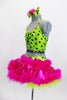 Cheerful 2 piece costume has striped neon green half top with black polk-a-dots. Hot pink skirt has feather edges & attached panty. Has matching bow & gauntlets. Side
