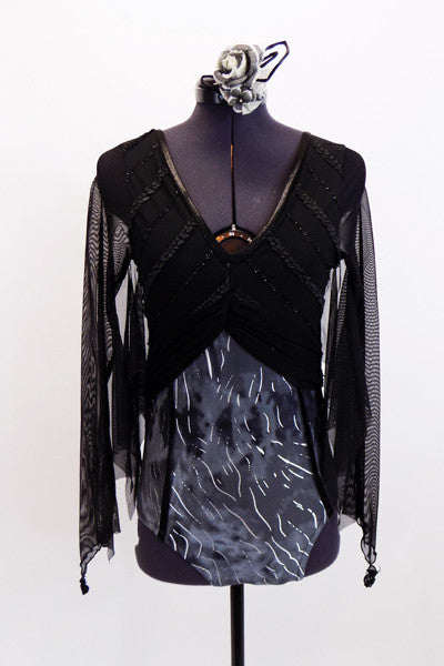 Deep V-front leotard has black bodice & a grey/silver streak bottom. Sheer long sleeves are shaped like bat wings.Has keyhole back, corset accent & matching black & silver hair accessory. Front
