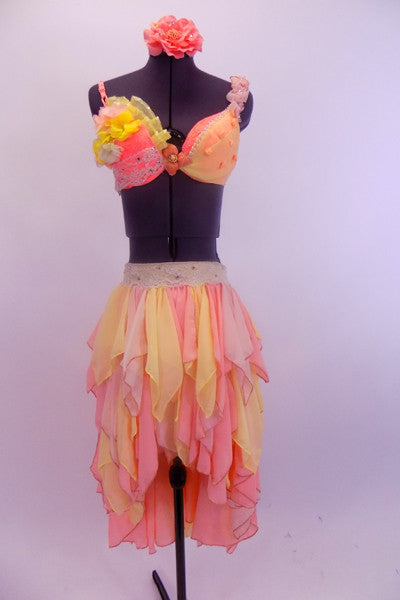 Peach lace bra with chiffon roses, pearls,crystals & lace has matching pale yellow brief  with peach accents & peach/yellow chiffon skirt with layers of chiffon kerchiefs. Has matching floral hair accessory. Front